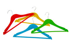 Coat-hangers. Colorful coat-hanges in red blue green and yellow Royalty Free Stock Photos