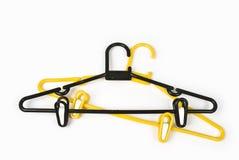 Coat hangers. Two modern design coat hangers royalty free stock image