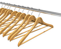 Coat hangers on clothes rail Stock Photos