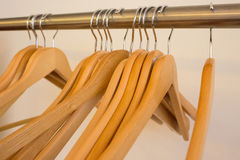 Coat hangers on clothes rail Stock Image