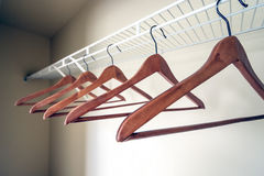 Coat hangers in an empty closet. Coat hangers on a clothes rail in an empty closet Royalty Free Stock Images