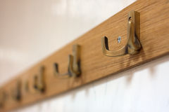 Coat hooks. Row of coat hangers shot with shallow DOF Royalty Free Stock Photography