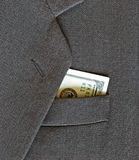 Coat and money Royalty Free Stock Image