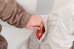 Coat pocket stealing Stock Images