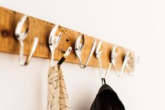 Coat rack made from creatively bent spoons Royalty Free Stock Photo