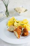 Coated cauliflower cut in half and chive potatoes Royalty Free Stock Photography