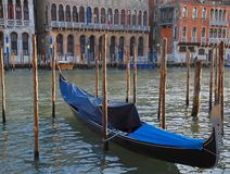 Coated Gondola on Canale Grande in Venice. In Italy royalty free stock photography