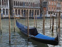 Coated Gondola on Canale Grande in Venice. In Italy stock photography