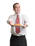 Coated Wiener on a Stick. A young businessman showing off his lunch, which is a coated wiener on a stick, isolated against a white background Stock Photos