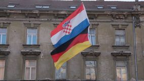 Coatian and German flag. Two flags, Croatian and German on the pole stock video