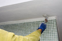 Coating of a cornice. In a construction site Stock Photos