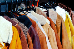 Coats. Rack with second hand retro winter coats stock image