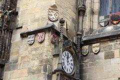 Coats of arms and clock of the ancient town hall in Prague Royalty Free Stock Image