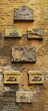 Coats of arms on an old brick wall Royalty Free Stock Photography