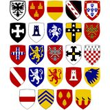 Coats of arms on the shields at the Hospitaller knights royalty free stock photos