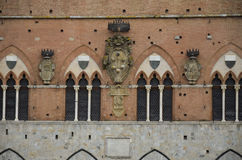 Coats of arms on the Town Hall, Siena Stock Photo