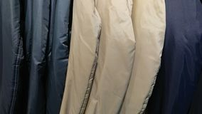 Coats Background. A line of colour coats on hangers royalty free stock images