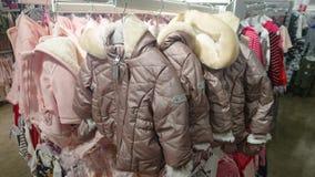 Coats on hangers. A line of coats on hangers stock photography