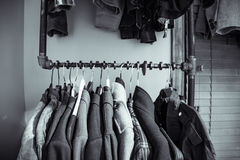 Coats and jackets having on a crank shaft. Retro coats and jackets hang on a crank shaft Royalty Free Stock Images