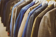Coats and jackets. Coats and jackets in second hand shop Stock Photos