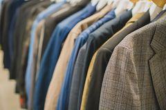 Coats and jackets. Coats and jackets in second hand shop stock photo