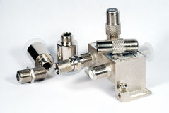 Coaxial accessories. White tv coaxial accessories close up shot Royalty Free Stock Image