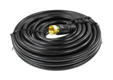 Coaxial cable. A new black coaxial cable showing the connector on a white background Stock Photo