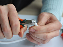 Coaxial cable to transmit satellite signals in hand. Closeup cable repair. Stock Images