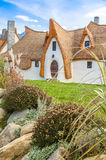 Cob clay house and garden. Transyslvanian Cob clay house and garden with Carpathian mountains in the background Stock Images
