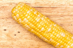 The Cob. Corn on a wood table Royalty Free Stock Photos