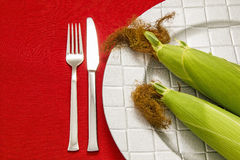 Cob and cutlery Stock Image