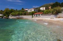 The cobalt blue Aegean sea and blue sky of Samos, Greece. The Aegean Sea on the beautiful wild rocky beach, blue sky on the Greek island of Samos Royalty Free Stock Photos