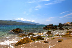 Cobalt blue Aegean sea and mountains. Samos, Greece. View of the coast of the Greek island of Samos. A view of the Aegean sea, mountains and rocks Royalty Free Stock Photography