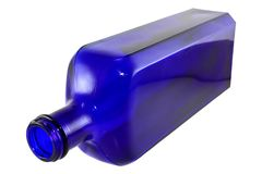 Cobalt blue Bottle. Antique cobalt blue bottle isolated against a white background Stock Images
