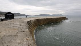 The Cobb famous Lyme Regis harbour wall Dorset England UK stock footage