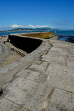 The Cobb Lyme Regis. Scenic view of the Cobb walk, harbor and pier in Lyme Regis, Dorset, England Stock Image