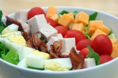 Cobb Salad. Close Up of Cobb Salad in a White Bowl stock photo