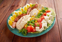 Cobb Salad. Colorful hearty entree sized salad with bacon, chicken, boiled eggs, corn, - a main-dish American garden salad stock images