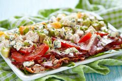 Cobb salad. Classic cobb salad with bacon, chicken, tomatoes, eggs, avocado and blue cheese stock photo