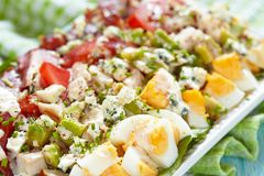 Cobb salad. Classic cobb salad with bacon, chicken, tomatoes, eggs, avocado and blue cheese stock image