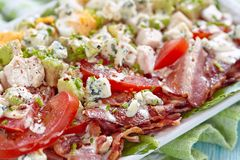 Cobb salad. Classic cobb salad with bacon, chicken, tomatoes, eggs, avocado and blue cheese royalty free stock photos