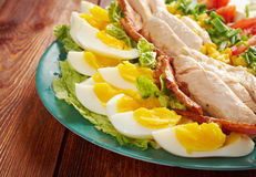 Cobb Salad. Colorful hearty entree sized salad with bacon, chicken, boiled eggs, corn, - a main-dish American garden salad stock photo