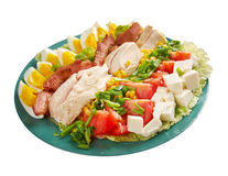 Cobb Salad. Colorful hearty entree sized salad with bacon, chicken, boiled eggs, corn, - a main-dish American garden salad ,isolated royalty free stock photos