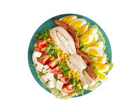 Cobb Salad. Colorful hearty entree sized salad with bacon, chicken, boiled eggs, corn, - a main-dish American garden salad ,isolated stock photo
