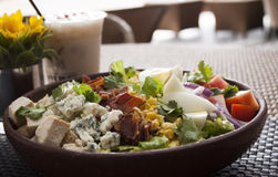 Cobb Salad. Fresh salad of romaine greens, sliced chicken breast, tomatoes, bacon, avocado, boiled egg, and blue cheese stock photos