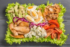 Cobb salad with fried chicken, avocado, eggs and tomatoes. Close-up Royalty Free Stock Photography