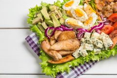 Cobb salad with fried chicken, avocado, eggs and tomatoes. Close-up Royalty Free Stock Photos