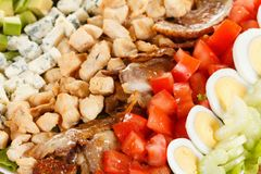 Cobb Salad - Traditional American food with bacon, chicken, eggs. Tomatoes stock image