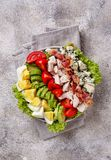 Cobb salad, traditional American food. Top view, space for text royalty free stock images