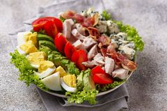 Cobb salad, traditional American food. Top view, space for text stock photo